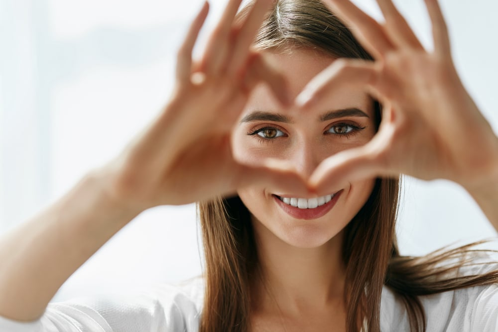 woman-showing-love-heart-with-hands